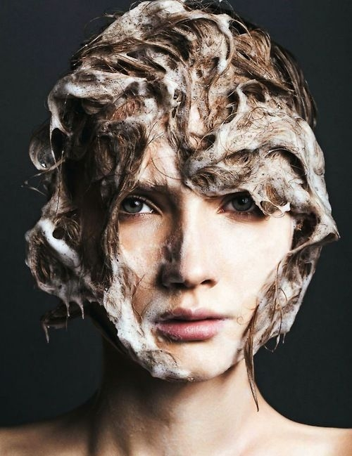 image of a model with shampoo on her hair